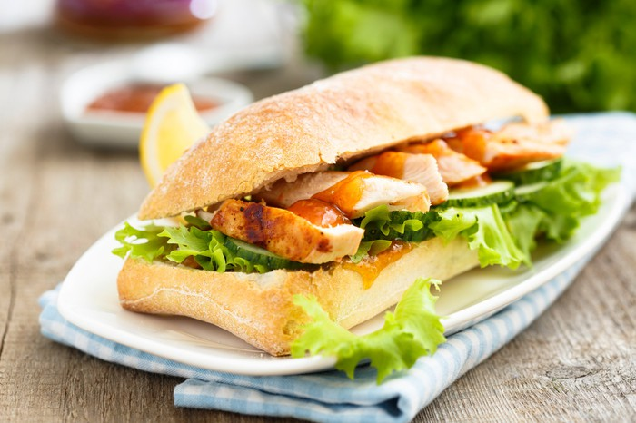 Grilled chicken sandwich with ciabatta bread.