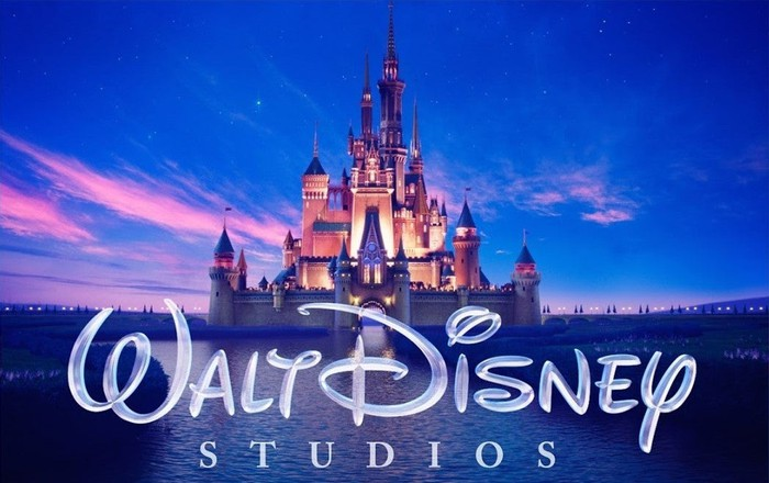 Walt Disney Studios logo with Cinderella Castle in the background