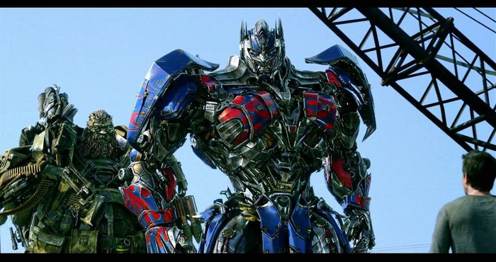 "Character looking at Optimus Prime and another transformer in Viacom's ""Transformers: The Last Knight."""