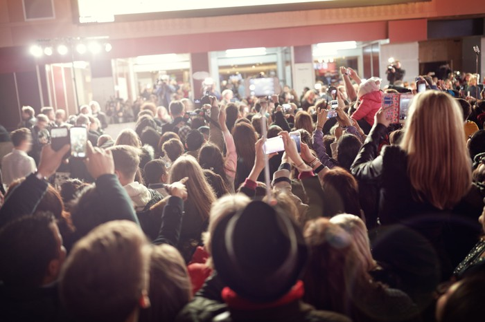 Crowd shooting photos at a red carpet movie premiere