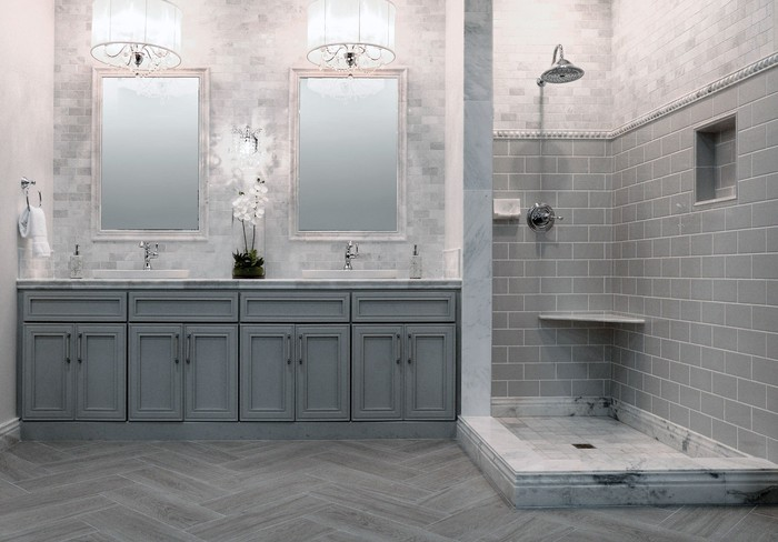 A bathroom decorated with grey colored tiles