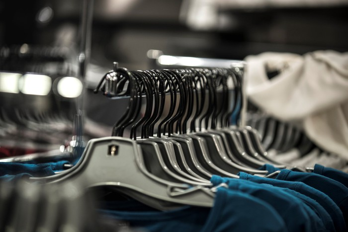 Blue shirts on hangers on a store display