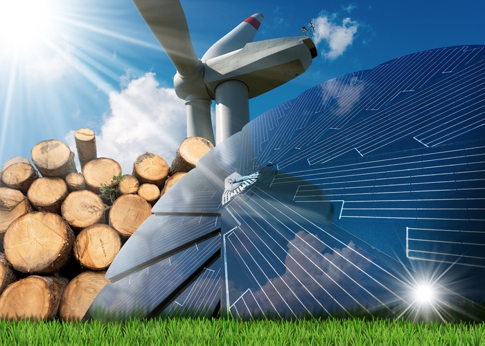 Renewable energy sources - Wind energy with a wind turbine, solar energy with a solar panel, biomass with a stack of logs.