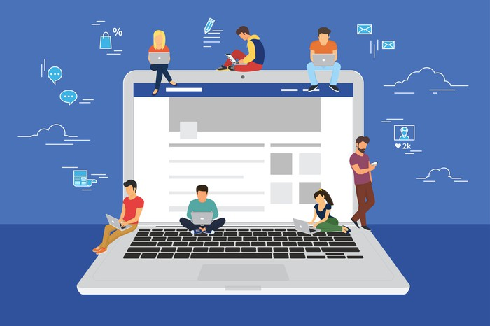 Concept art of professionals seated on a giant laptop surfing Facebook from their own computers