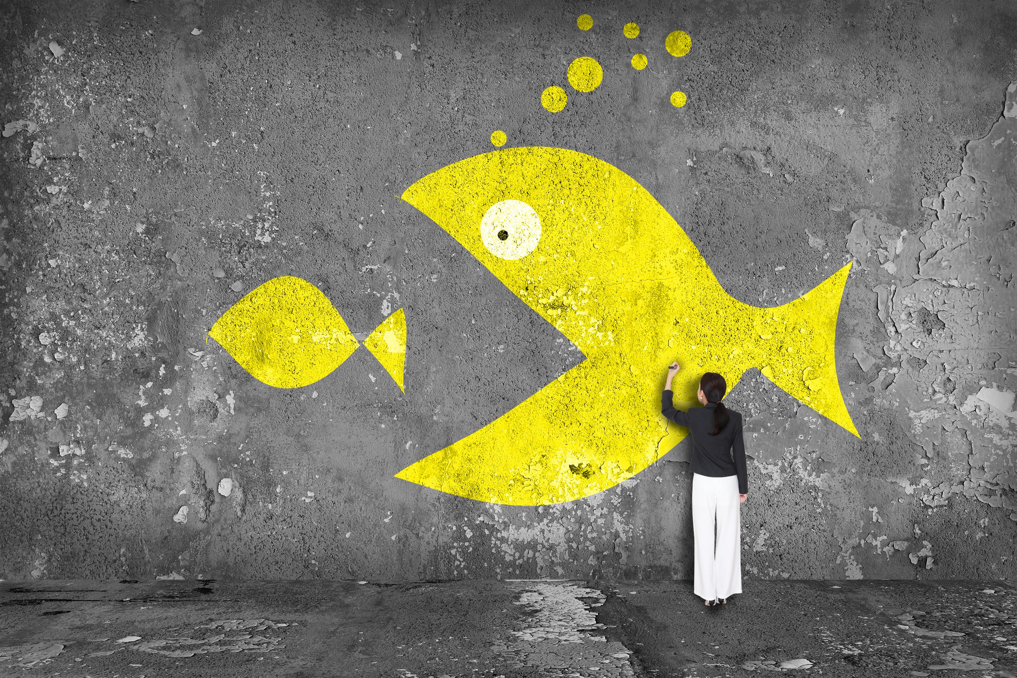 Painting of large yellow fish chasing small yellow fish