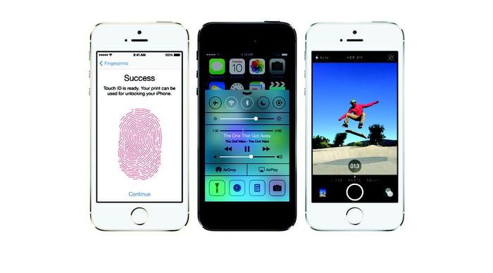 Three Apple iPhone 5s smartphones.