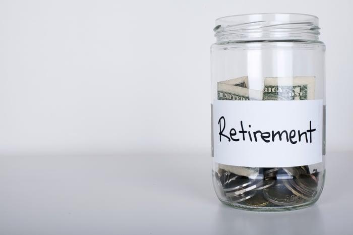 "Jar of money labeled ""retirement."""