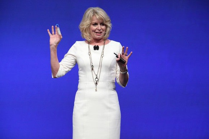 Intel executive Diane Bryant holding up a silicon photonics module.