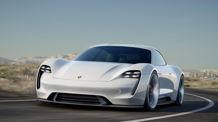 Porsche Mission E Concept, a white four-door sports car.