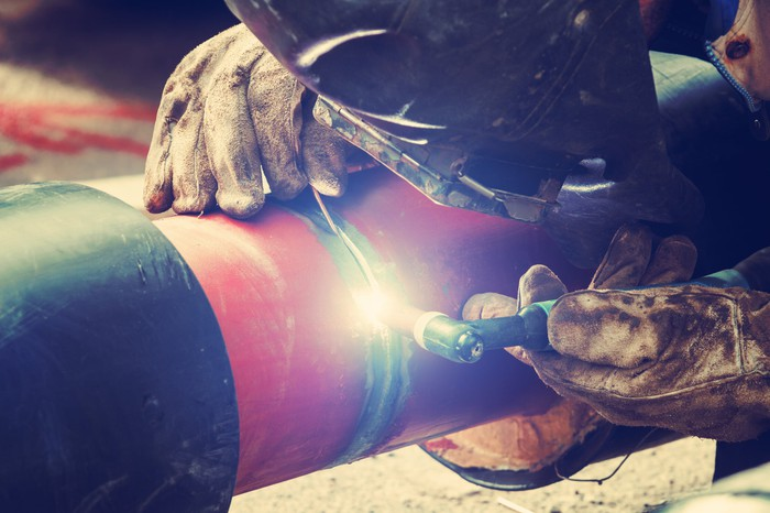 A welder working on a pipe.