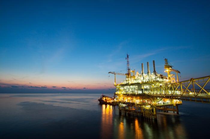 Oil production platform at night.