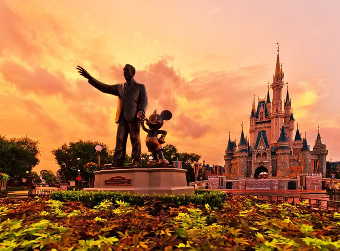 A statue of Walt Disney and Mickey Mouse at Walt Disney World in Orlando, Florida.