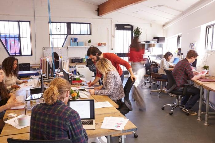 People work in an open office.