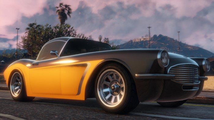 A car driving down the street in 'Grand Theft Auto V'.