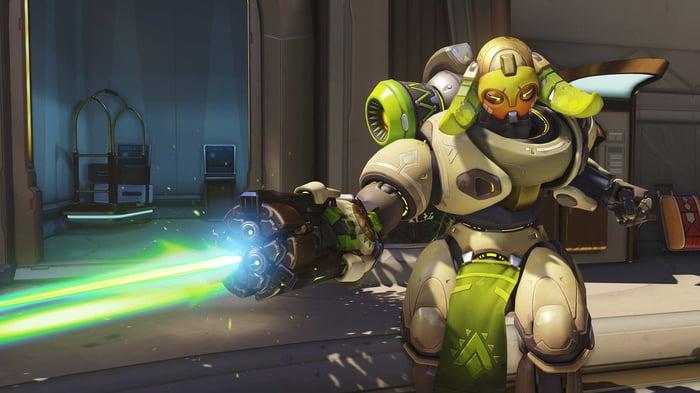 """'Overwatch"""" character shooting a laser gun."""