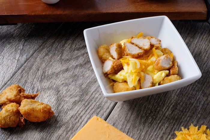 Chick-fil-A's new breakfast bowl with sliced chicken nuggets.