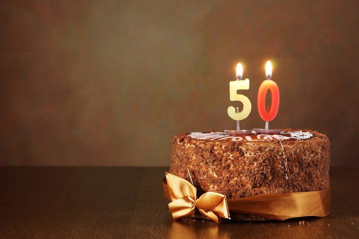 Chocolate cake with number 50 candles.