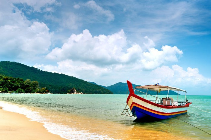 A boat moored on a beach in Malaysia.