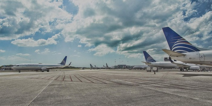 Several Copa Airlines planes parked on the tarmac