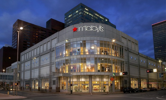 The exterior of a Macy's store in downtown Cincinnati, seen at night.
