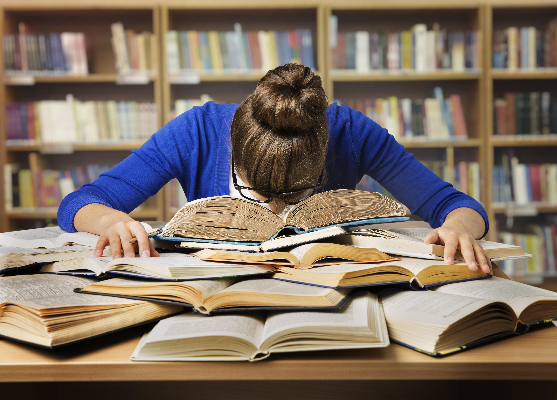 Student Studying Hard Exam and Sleeping on Books