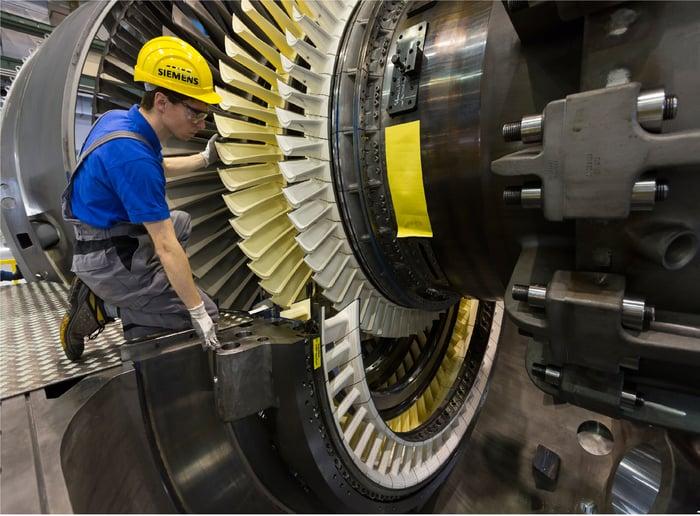 a Siemens technician fitting a gas turbine