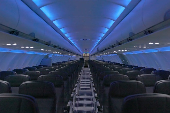 The new interior for JetBlue's A320s features mood lighting and larger TV screens.