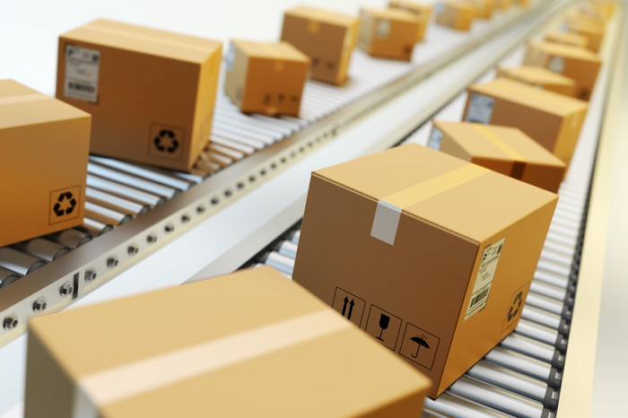 Packages rolling down a line, waiting to be shipped.
