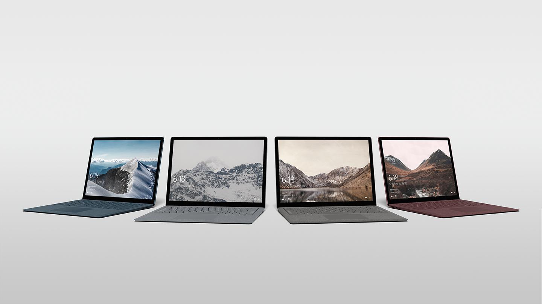 Four Microsoft Surface laptops.