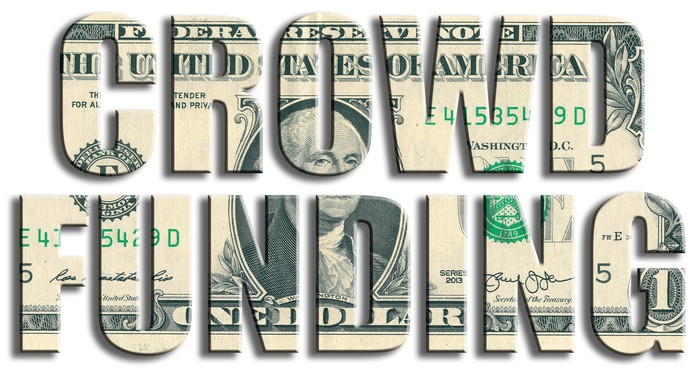 Crowd funding spelled out on dollar bill background