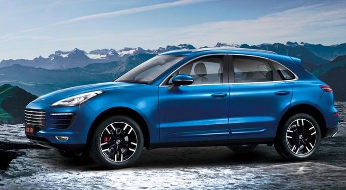 A blue Zotye SR9 SUV is shown on a snowy road.
