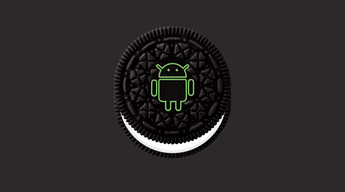 A green Android figure on an Oreo cookie.