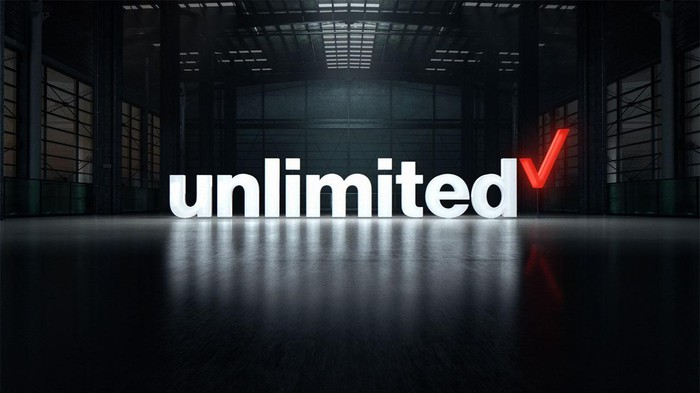 3D Verizon unlimited logo superimposed in a warehouse.