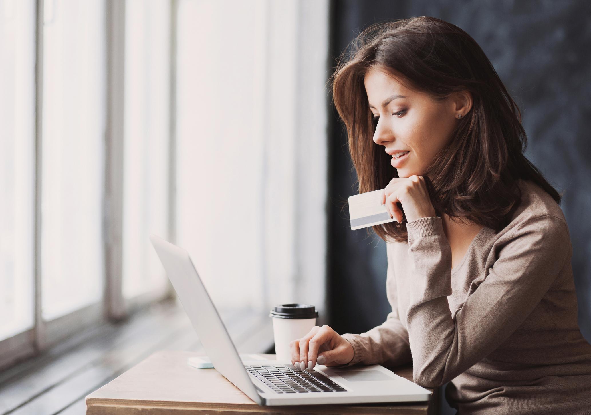 Woman shopping on laptop.