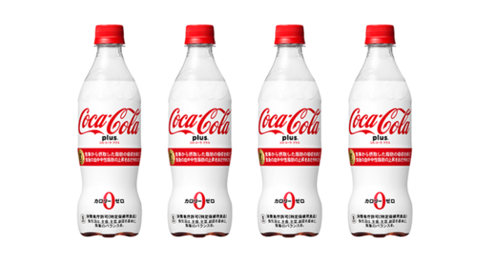 "Line of four ""Coca-Cola Plus"" white and red Japanese beverage bottles."