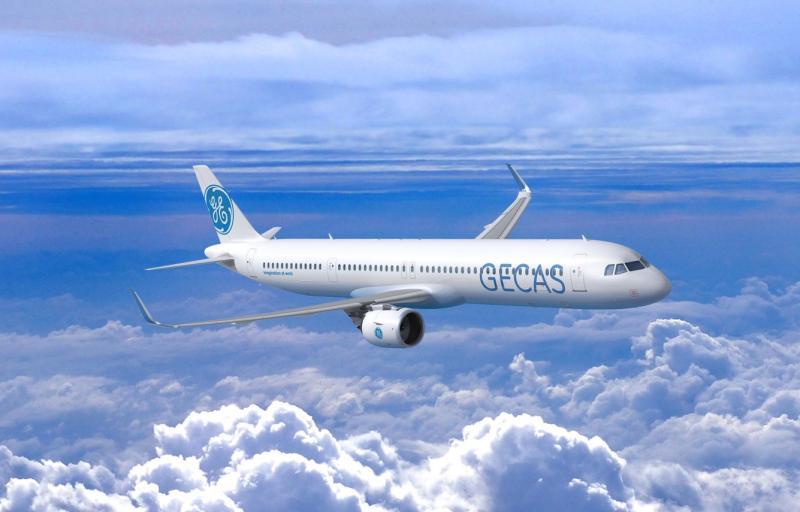 Airplane in flight above cumulus clouds against blue sky.