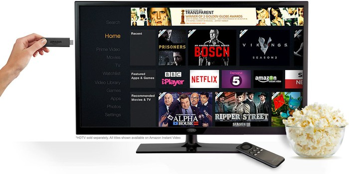 Amazon Fire TV Stick being inserted in TV