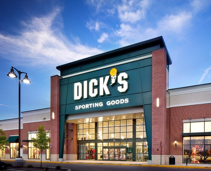 A Dick's storefront with blue sky in the background.