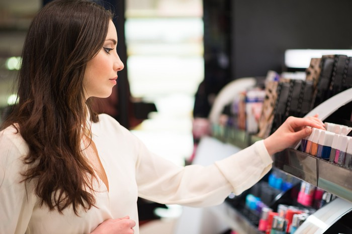A woman shops for cosmetics.