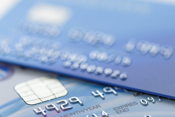 A close-up shot of two credit cards, one lying on top of the other.