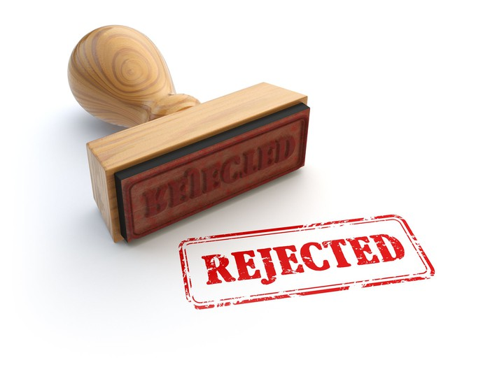 "A rubber stamp on a white background that reads, ""Rejected."""