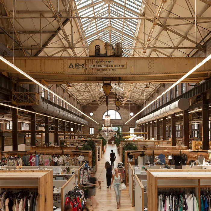 The interior of one of Urban Outfitters' stores. An old urban building restored by the company's designers and is stocked with clothes and home items.