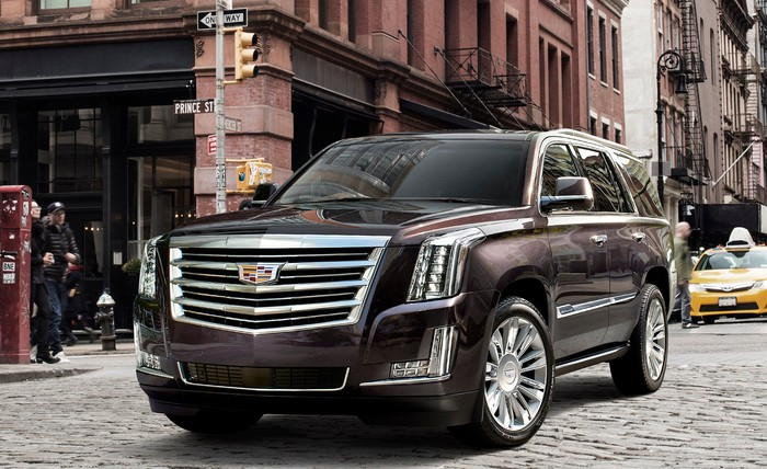 A 2017 Cadillac Escalade SUV in an urban setting.