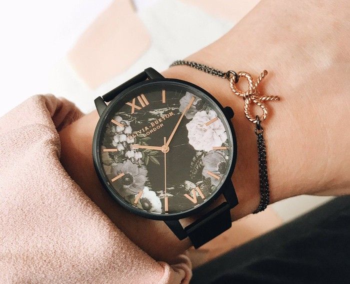 An Olivia Burton watch on a woman's wrist