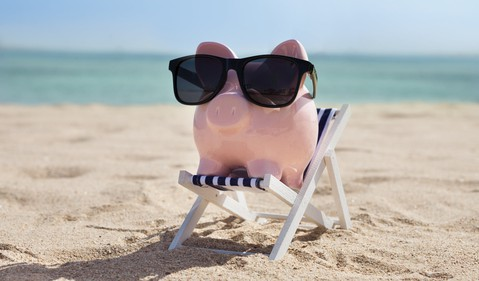 Getty Piggy Bank with Sunglasses on Beach
