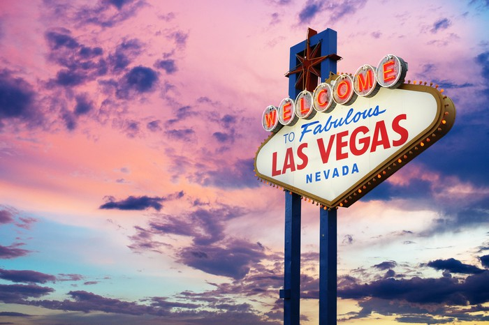 The welcome to Las Vegas sign with a colorful sky in the background.