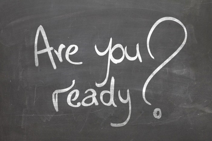 "A blackboard has the words ""Are you ready?"" wrritten on it."
