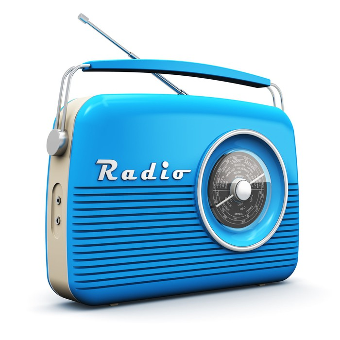 """A blue radio with the word """"radio"""" on it."""