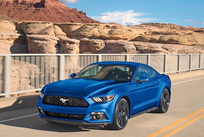 A blue 2017 Ford Mustang on a desert road.