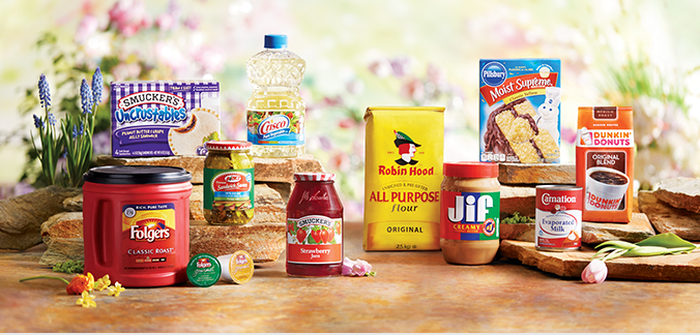 A grouping of popular Smuckers products, including Crisco oil and Jif peanut butter.